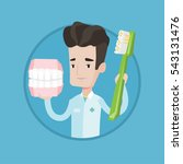 young friendly dentist holding... | Shutterstock .eps vector #543131476