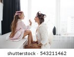 cute little girl doing makeup... | Shutterstock . vector #543211462