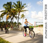 Miami, Florida USA December 3, 2012: Young girl riding bike in Miami Beach - stock photo