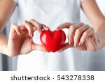Woman Holding Red Heart In...