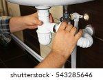 hands of plumber assembling... | Shutterstock . vector #543285646