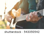 happy women playing guitar in...   Shutterstock . vector #543350542