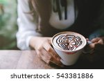 Woman Holding A Cup Of Coffee...