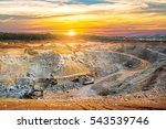 Small photo of Aerial view of opencast mining quarry with lots of machinery at work - view from above.This area has been mined for copper, silver, gold, and other minerals