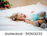 the charming little girl lies... | Shutterstock . vector #543616132