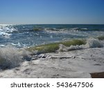 Small photo of Blue sky and agitated waves