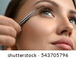 eyelash extension. hand with... | Shutterstock . vector #543705796