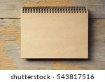 brown notebook on wooden table | Shutterstock . vector #543817516