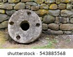 old millstone on a background...   Shutterstock . vector #543885568