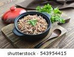 buckwheat porridge in black... | Shutterstock . vector #543954415
