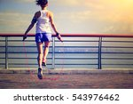 young fitness woman jumping... | Shutterstock . vector #543976462