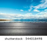 asphalt road near water in... | Shutterstock . vector #544018498