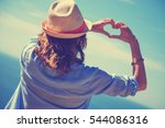girl holding a heart shape for... | Shutterstock . vector #544086316