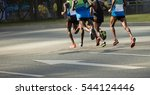 marathon runners running on... | Shutterstock . vector #544124446