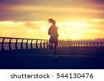 young fitness woman running at...   Shutterstock . vector #544130476