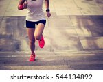 young sporty woman running on... | Shutterstock . vector #544134892