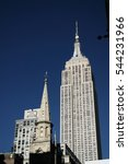 Empire state building, blue sky background, view from below - stock photo