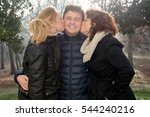 A Man Surrounded By Two Women...