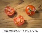 Small photo of Risp tomatoes on wooden background