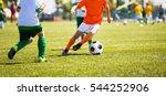 boys kicking soccer ball.... | Shutterstock . vector #544252906