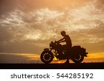 Silhouette Biker With His...