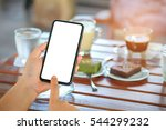 smart phone in hand with coffee ... | Shutterstock . vector #544299232