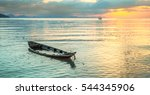 Sinking Boat At Sea Against Th...