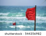 red warning flag on beach | Shutterstock . vector #544356982