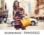 fashionable brunette woman in a ... | Shutterstock . vector #544410322