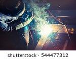 welders working as the industry ... | Shutterstock . vector #544477312