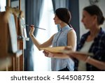 girl painting | Shutterstock . vector #544508752