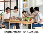 chinese family having lunch | Shutterstock . vector #544625806
