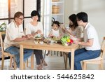 chinese family having lunch | Shutterstock . vector #544625842