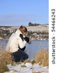 Attractive girl photographing Scottish countryside - stock photo