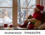 cute little girl sitting by the ... | Shutterstock . vector #544666396