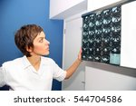 doctor looks at computed... | Shutterstock . vector #544704586