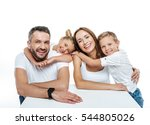 Smiling Family In White T...