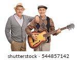 Cheerful Seniors Playing A...