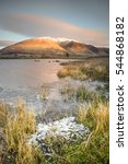Small photo of A winter sunrise over Tewet Tarn in the English Lake District