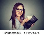 happy woman taking out money... | Shutterstock . vector #544905376