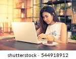 asian woman working with laptop ... | Shutterstock . vector #544918912