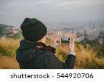BARCELONA, SPAIN - DECEMBER 25, 2015: Girl taking picture of Barcelona panorama - stock photo