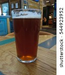 Small photo of a pint of British ale beer in a pub