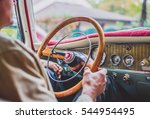 Man driving on the road retro car. Vintage style image. - stock photo