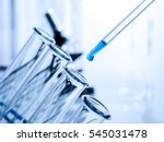 pipette adding fluid to one of... | Shutterstock . vector #545031478