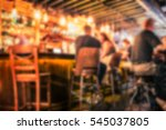 Stock photo defocused pub blur with people at the bar 545037805
