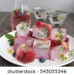 ice cubes and fruit water | Shutterstock . vector #545055346