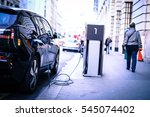 charging electric car on the... | Shutterstock . vector #545074402