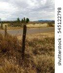 Fence Post On Rural Desert Road ...