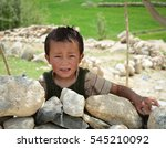 Small photo of Leh, India - Jul 17, 2015. A Tibetan boy at a village in Nubra Valley, India. 65% of children attend school, but absenteeism of both students and teachers remains high.